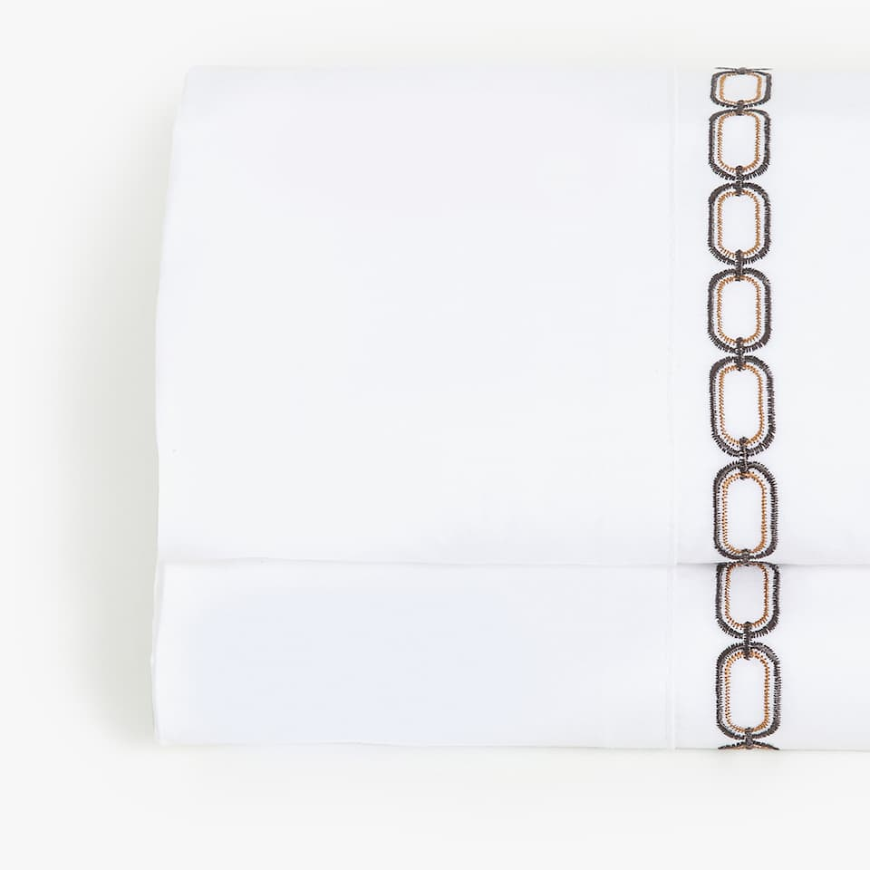EMBROIDERED CHAIN TOP SHEET