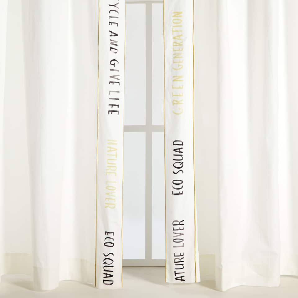 COTTON CURTAIN WITH SLOGAN