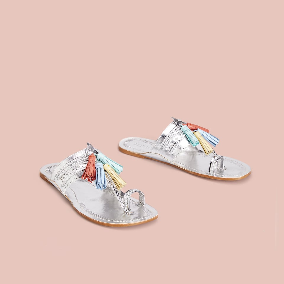 METALLIC SANDALS WITH POMPOMS
