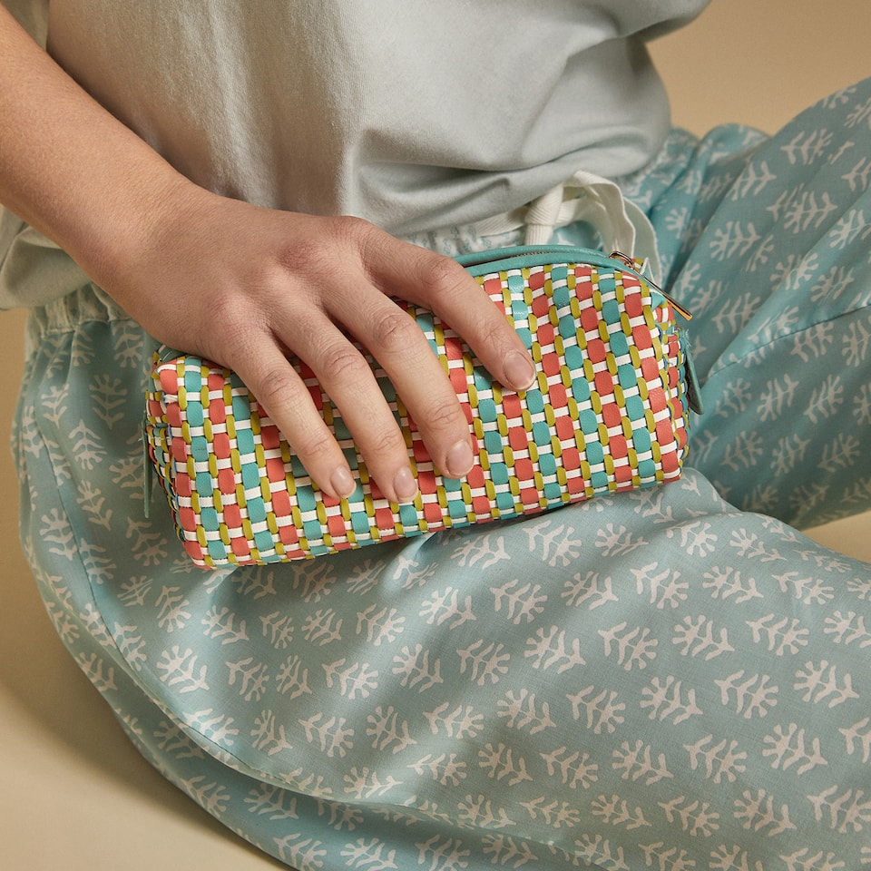 BRAIDED TOILETRY BAG