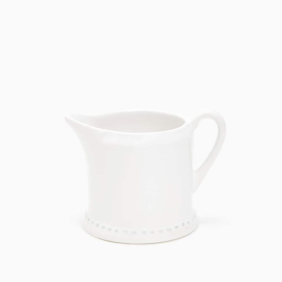 EARTHENWARE RAISED-DESIGN EDGE MILK JUG