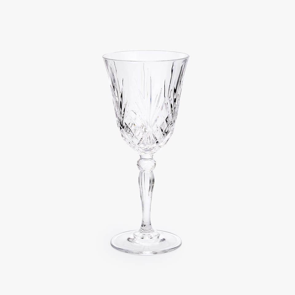 CRYSTALLINE WATER GLASS WITH RAISED DESIGN