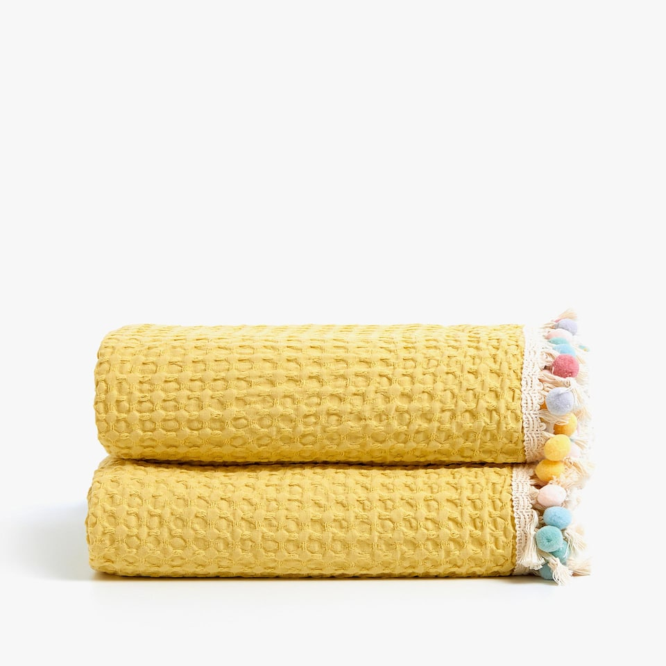 MULTICOLOURED WAFFLE KNIT COTTON BEDSPREAD WITH POMPOMS