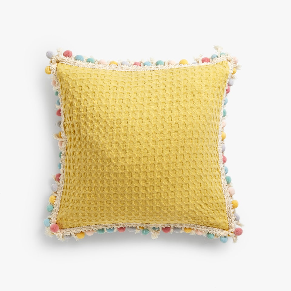 MULTICOLOURED WAFFLE KNIT COTTON CUSHION COVER WITH POMPOMS