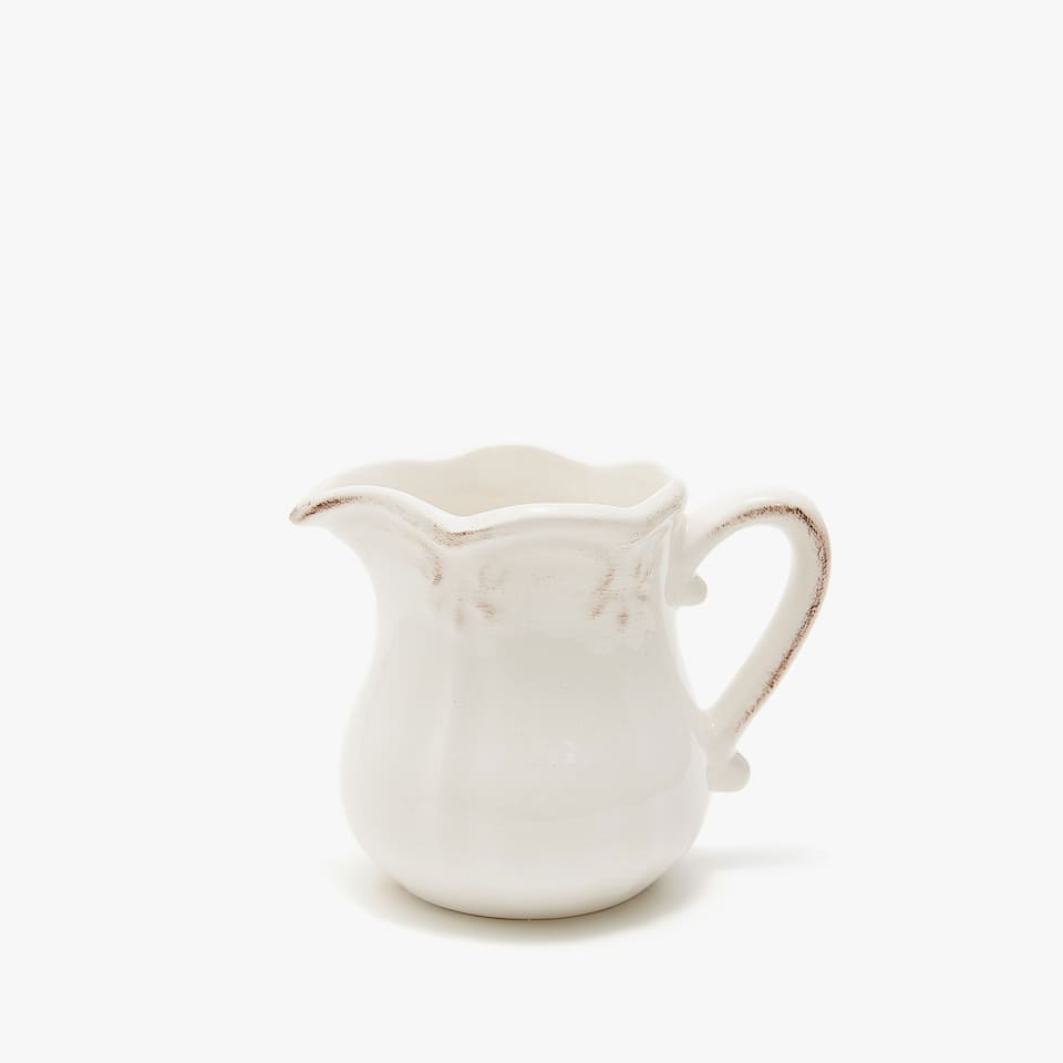 SCALLOPED EARTHENWARE MILK JUG