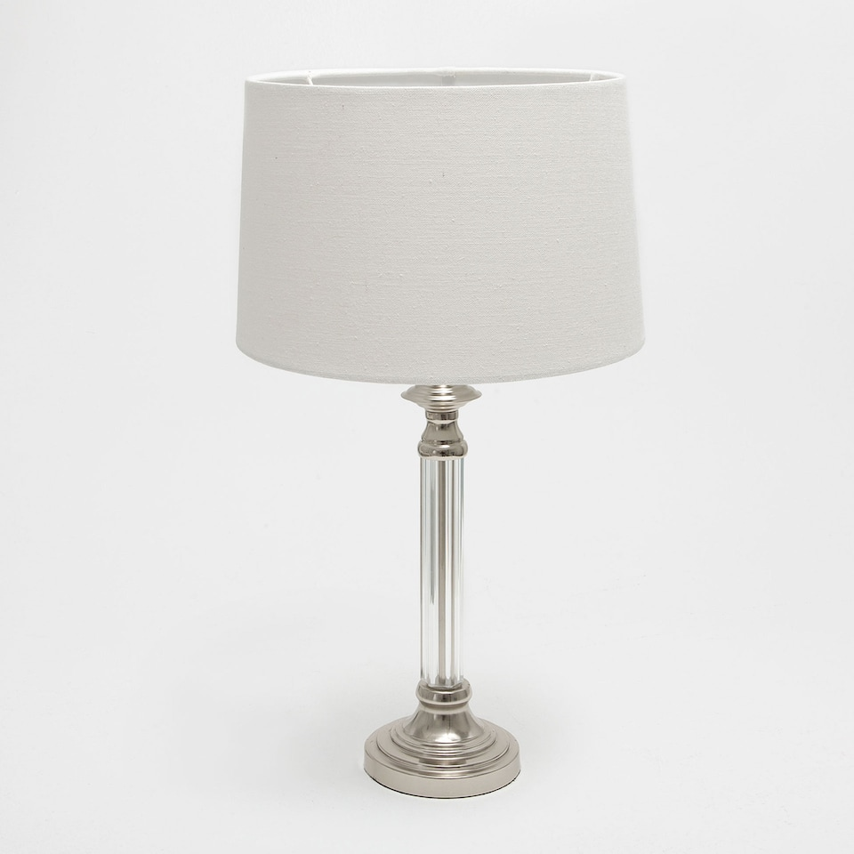 Lamp with a silver base and transparent stand