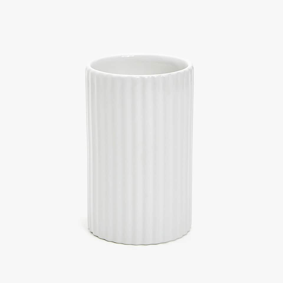 CERAMIC TUMBLER WITH A RAISED DESIGN