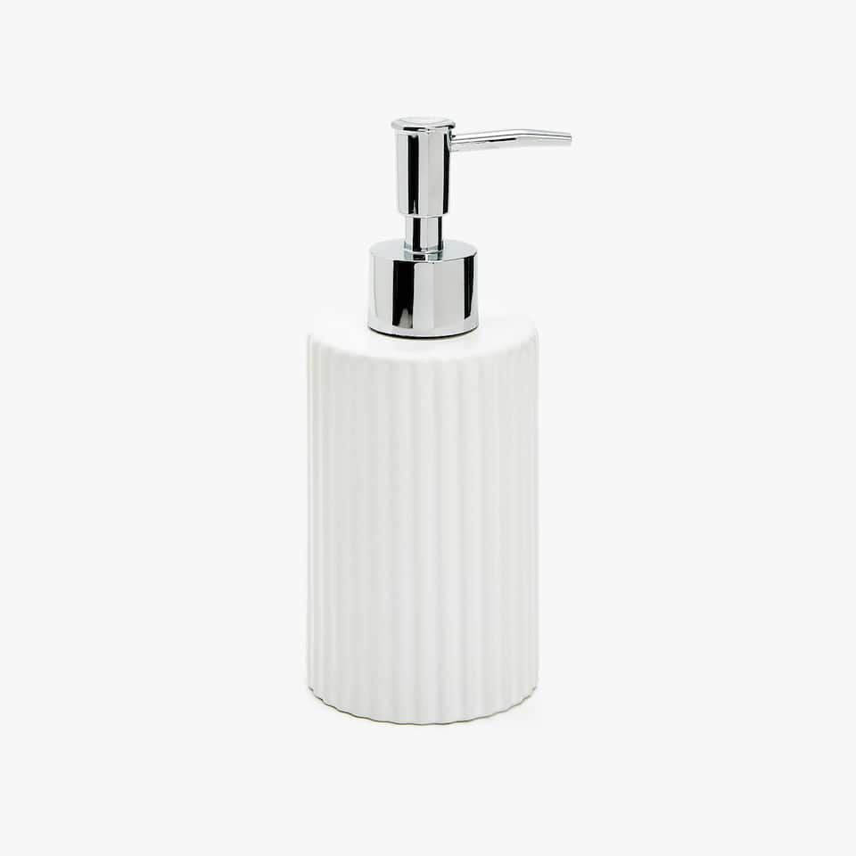 CERAMIC DISPENSER WITH A RAISED DESIGN