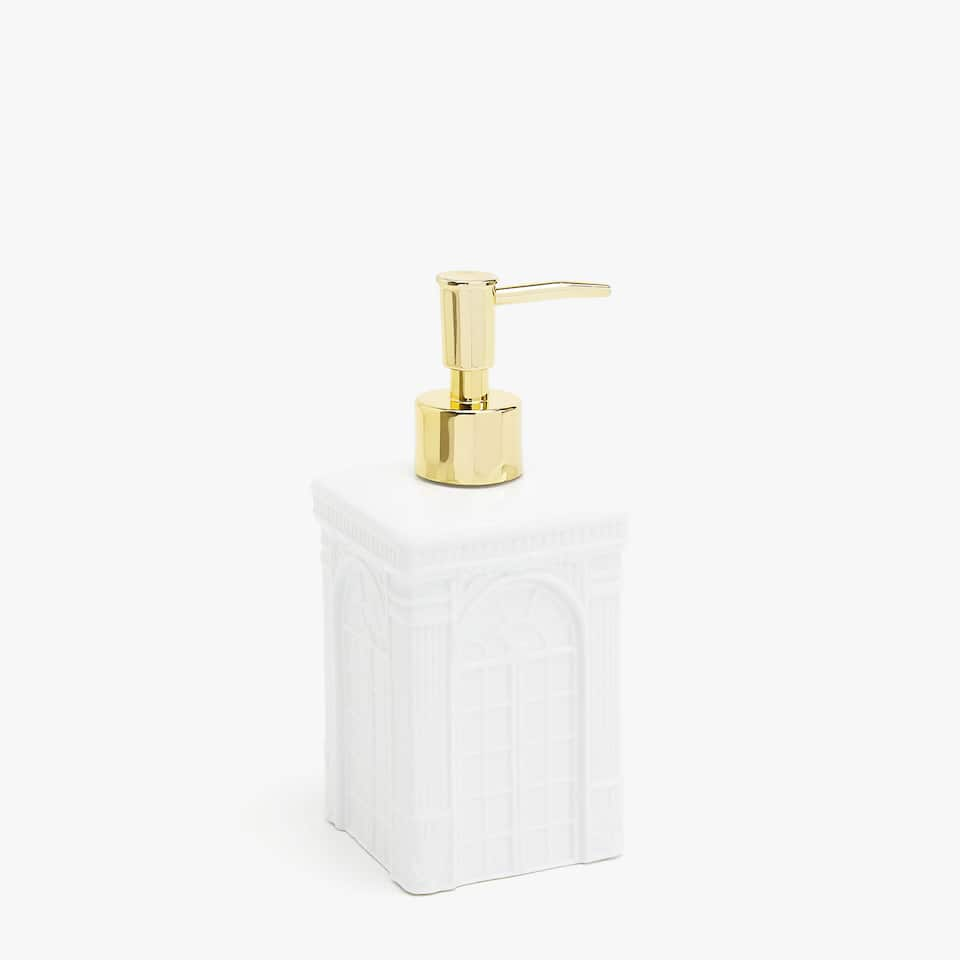 Soap dispenser with embossed palace design