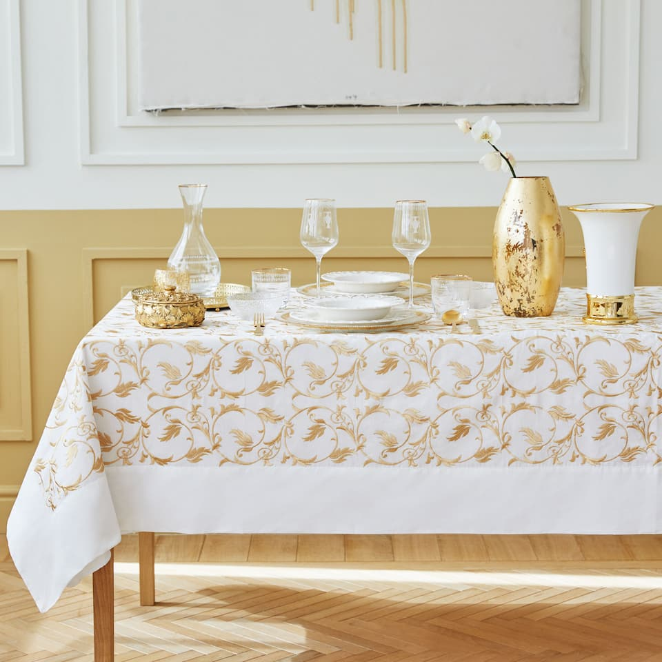 White tablecloth with gold embroidery
