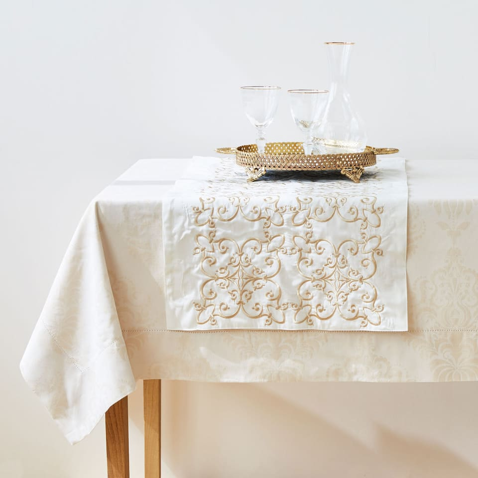 White embroidered cotton table runner