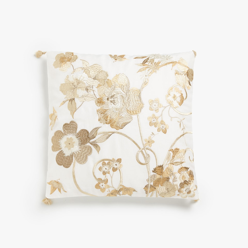 Cushion cover with floral embroidery and tassels