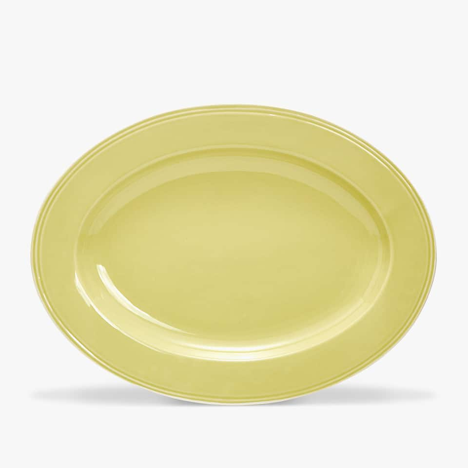 WHITE-RIMMED GREEN EARTHENWARE SERVING DISH