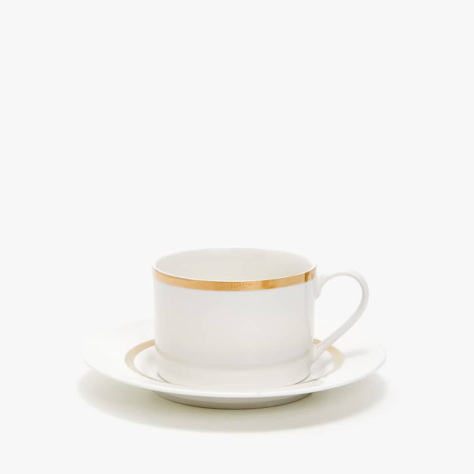GOLD-RIMMED PORCELAIN TEACUP AND SAUCER