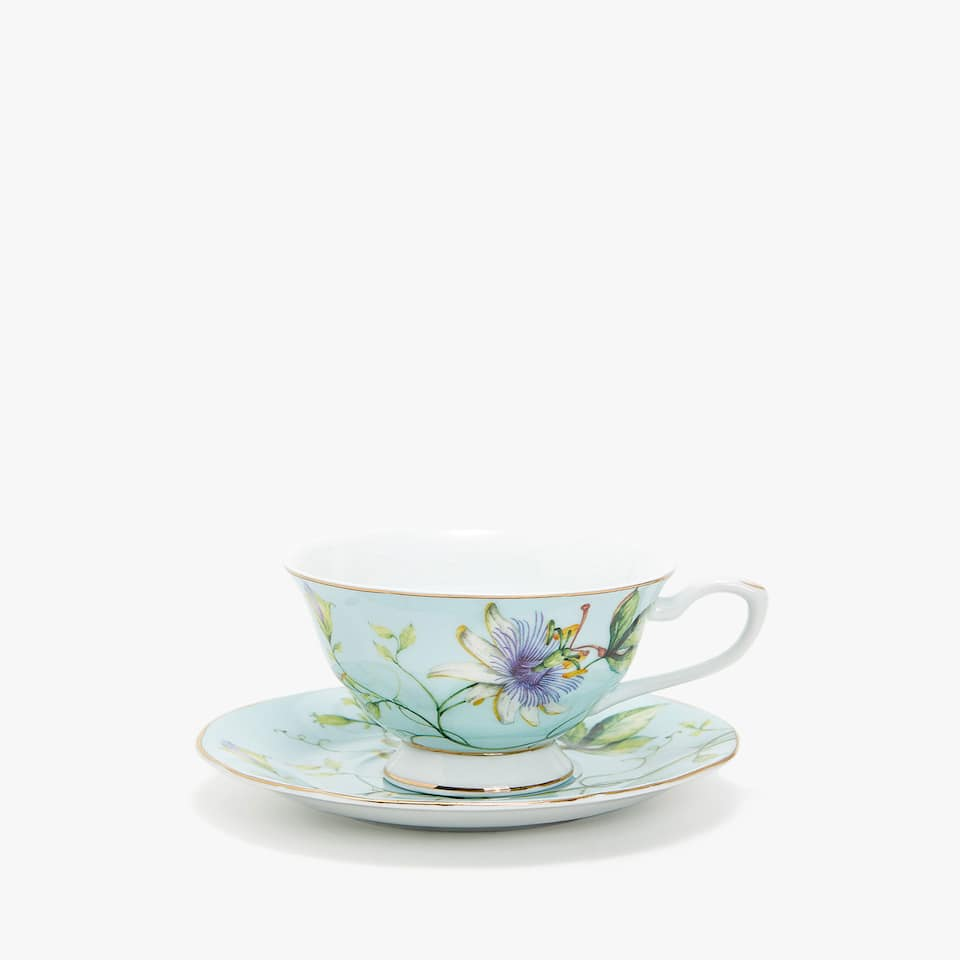 PORCELAIN TEACUP AND SAUCER WITH FLORAL TRANSFER