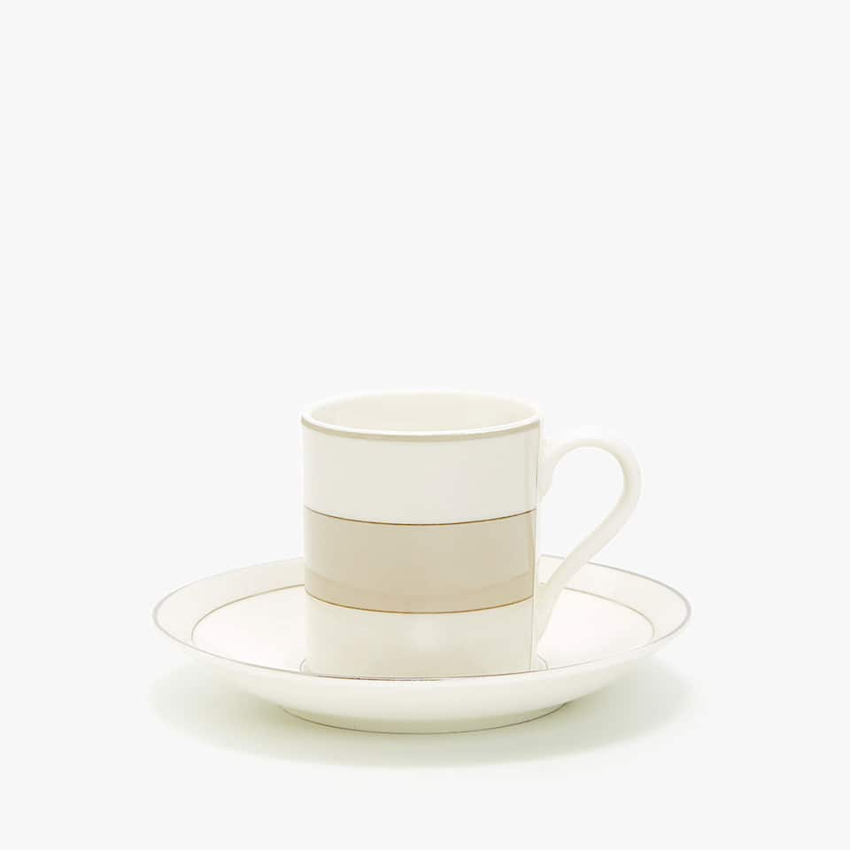 PORCELAIN COFFEE CUP AND SAUCER WITH DECORATED RIM