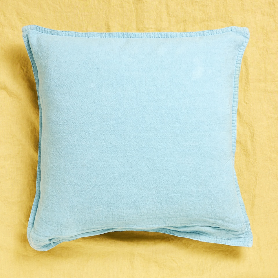 Faded linen cushion cover