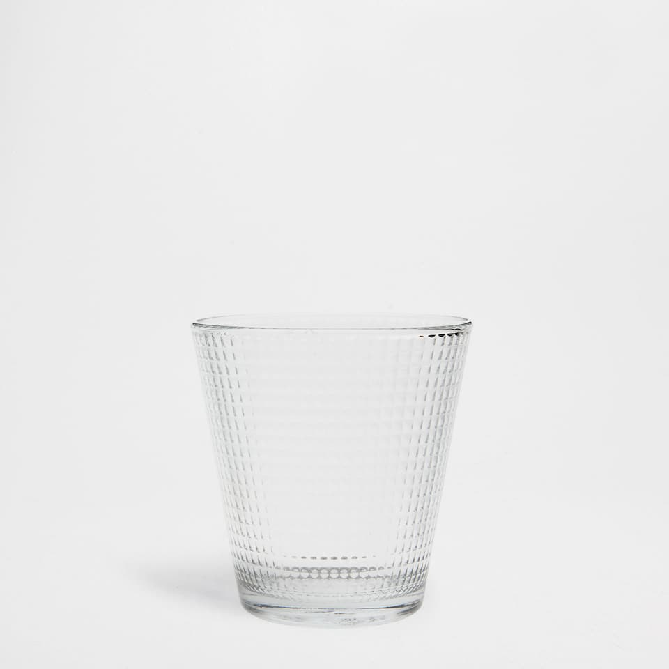 Raised geometric design tumbler