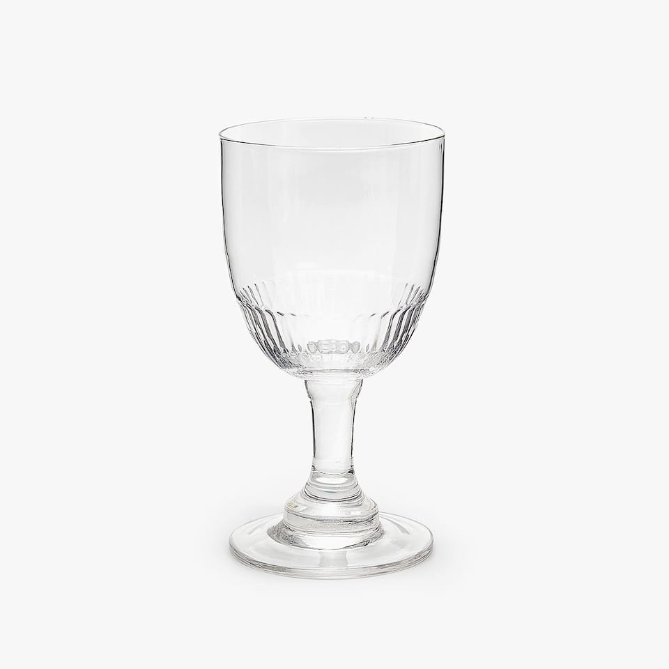 WINE GLASS WITH RAISED DESIGN ON BASE