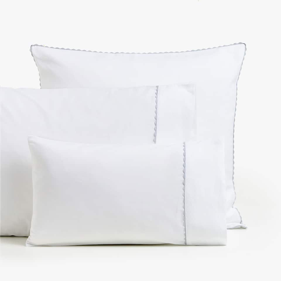 PIQUÉ PILLOWCASE WITH RIBBON OVERLAY