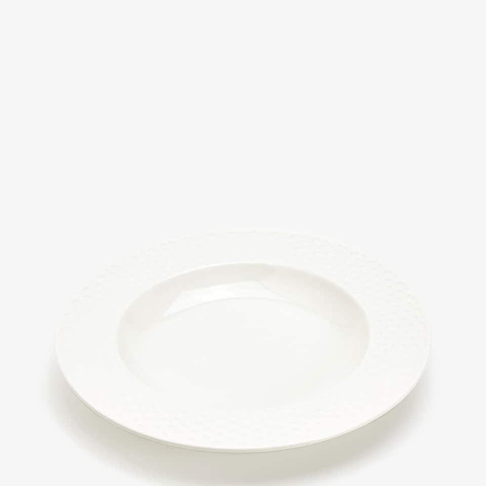 PORCELAIN SOUP PLATE WITH RAISED-DESIGN RIM