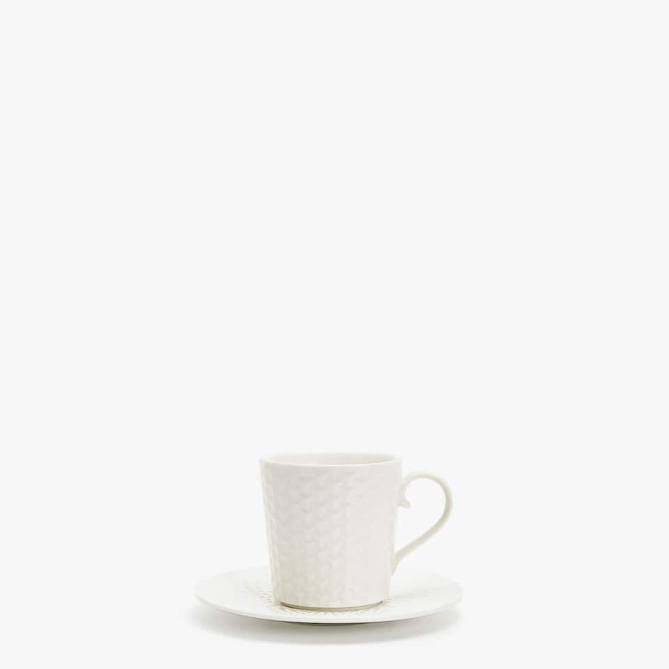 COFFEE CUP AND SAUCER WITH RAISED-DESIGN RIM