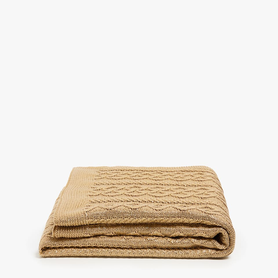 Gold cable knit blanket