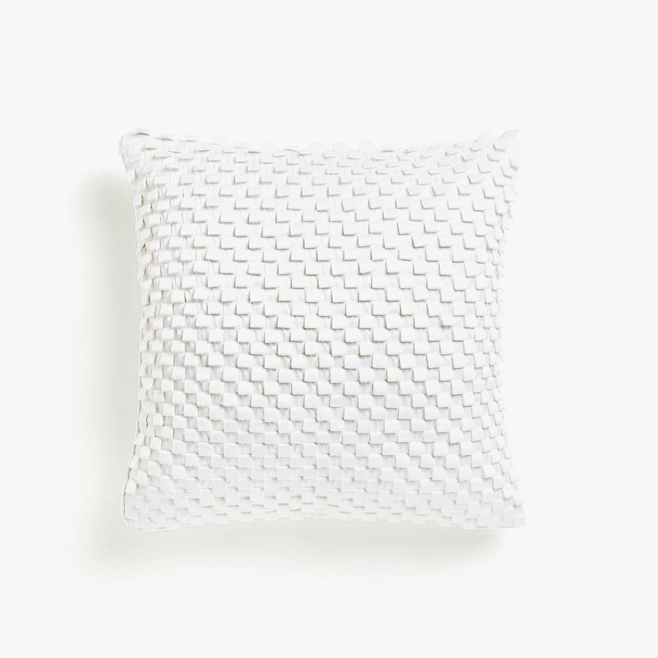 Cushion cover with a raised geometric design