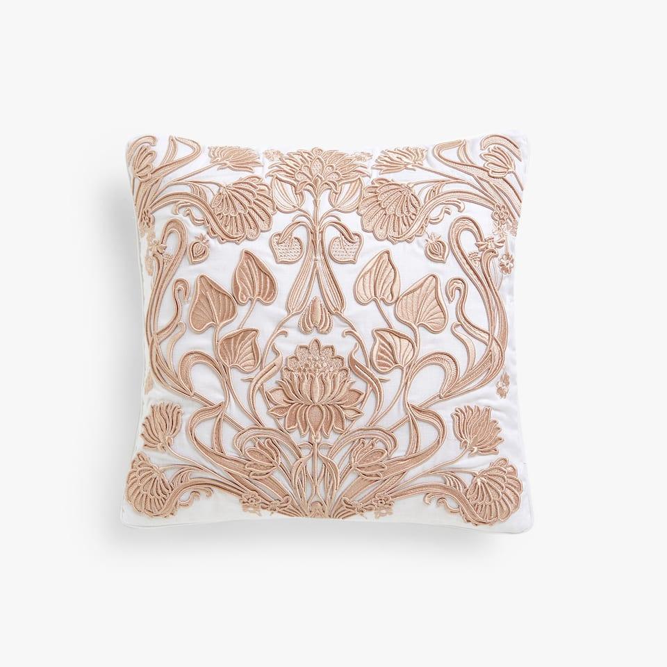 Embroidered cushion cover with decorative raised design