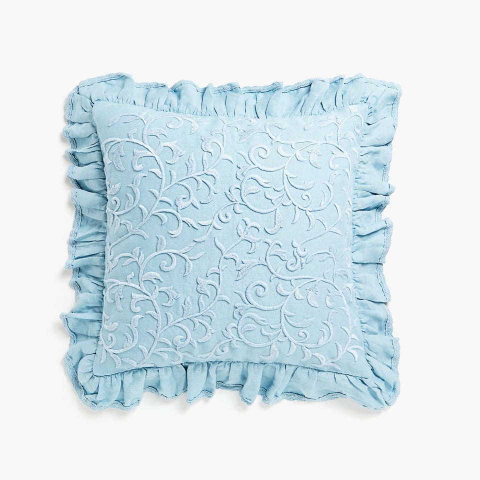 Frilled cushion cover with embroidery