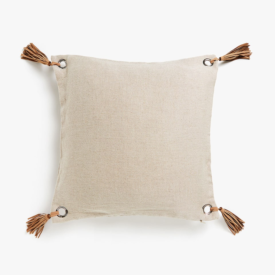 Linen cushion cover with metal rings