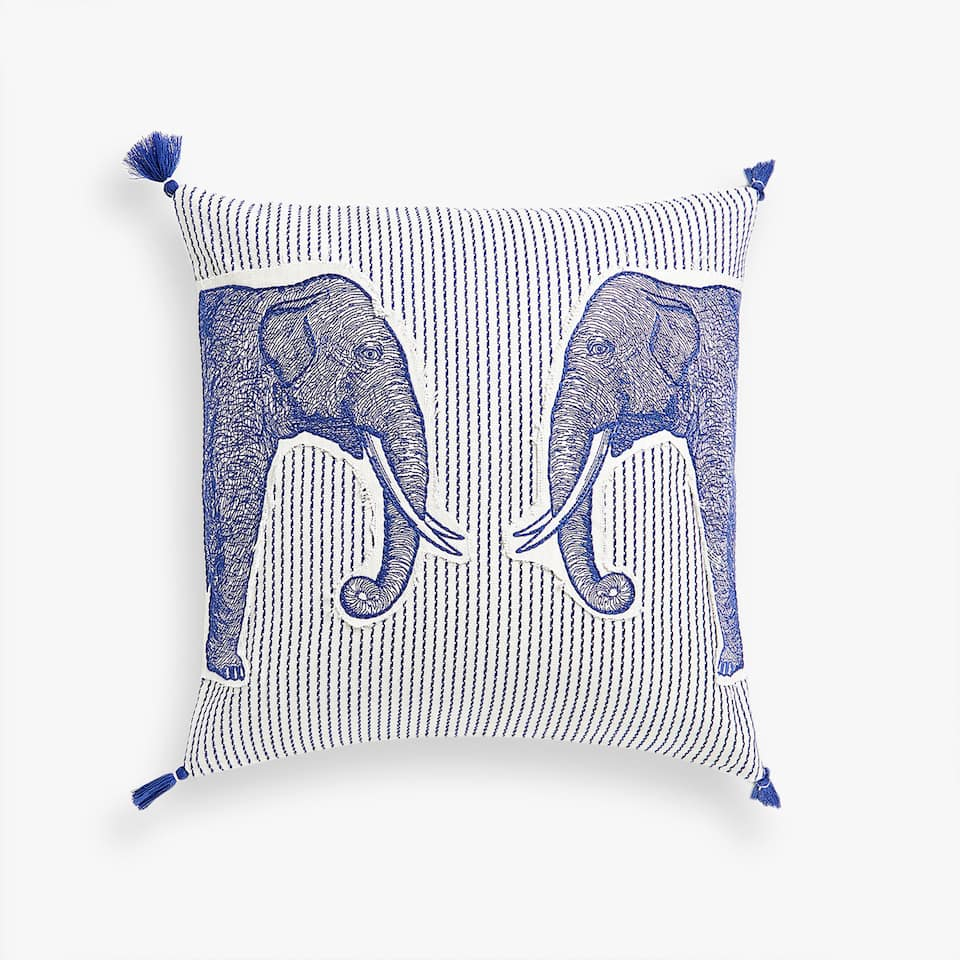 Cushion cover with elephant appliqués