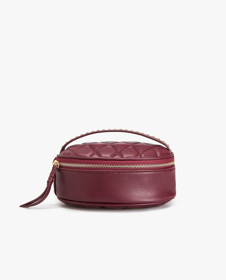 STUDDED OVAL TOILETRY BAG