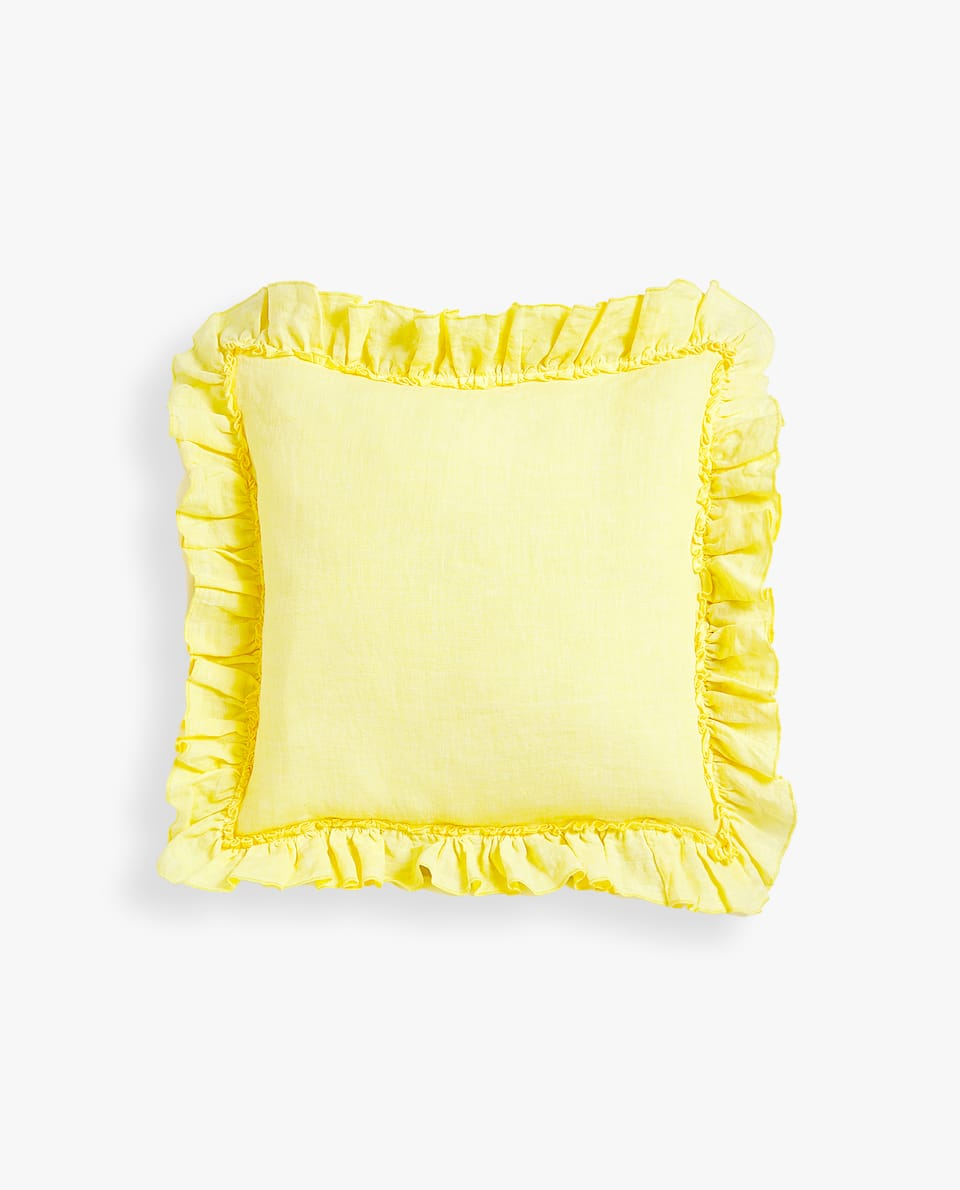 CUSHION COVER WITH RUFFLE AND OVERLOCK DETAIL