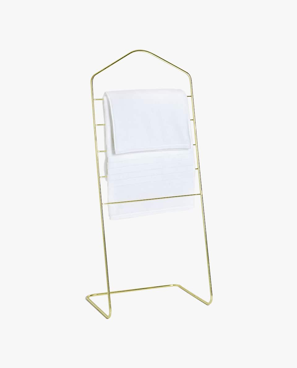 IRON CLOTHES RACK WITH A GOLDEN STRUCTURE