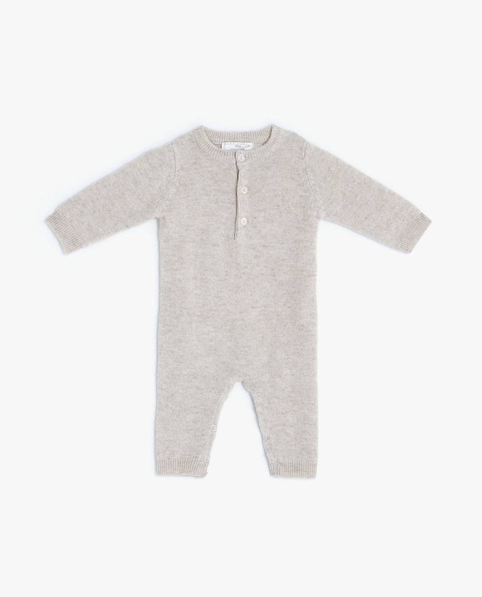 CASHMERE ROMPER SUIT WITH FRONT BUTTONS