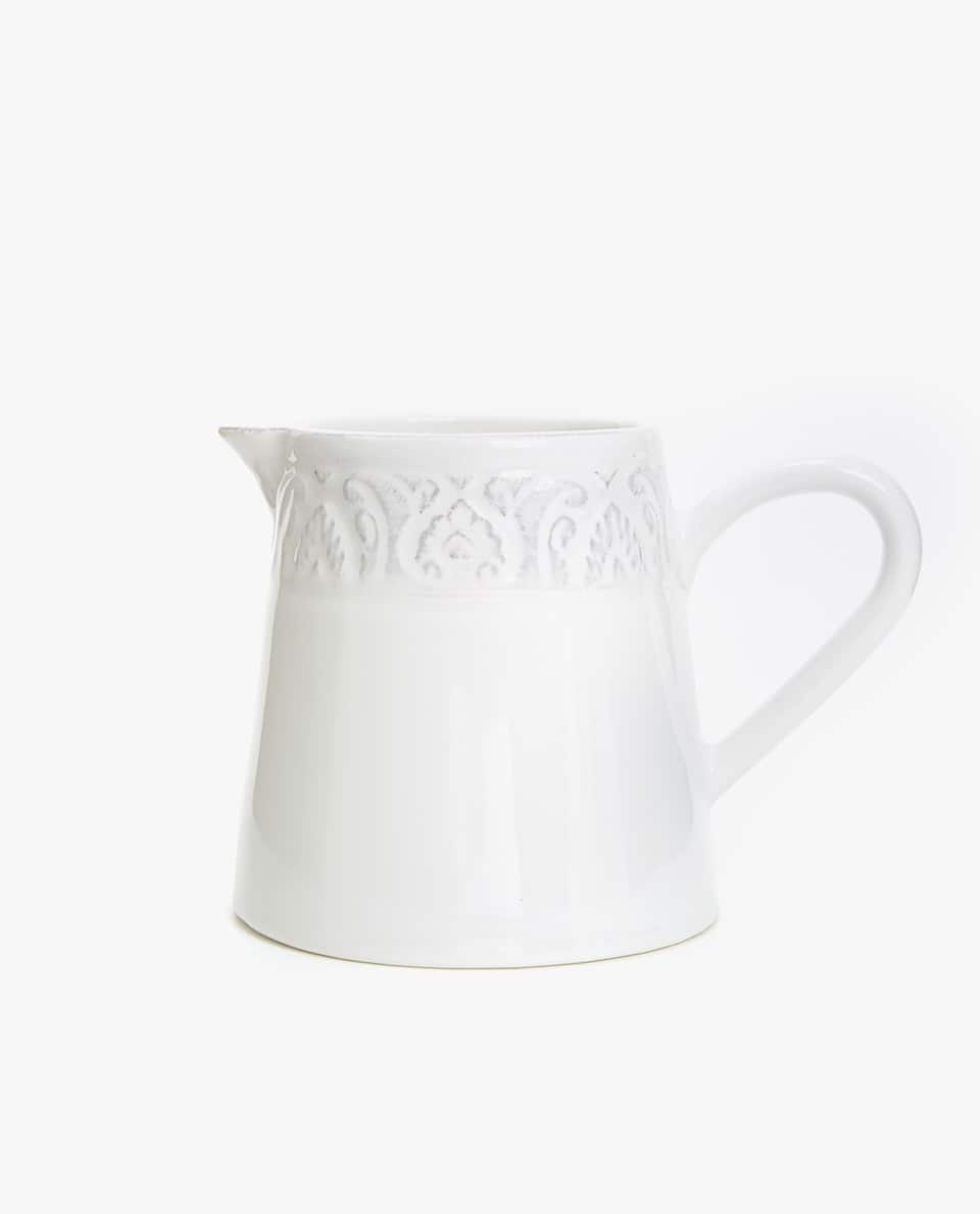 WHITE RAISED-DESIGN EARTHENWARE MILK JUG