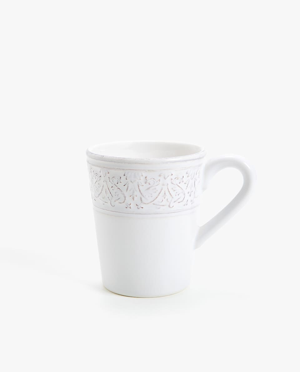 WHITE RAISED-DESIGN EARTHENWARE MUG