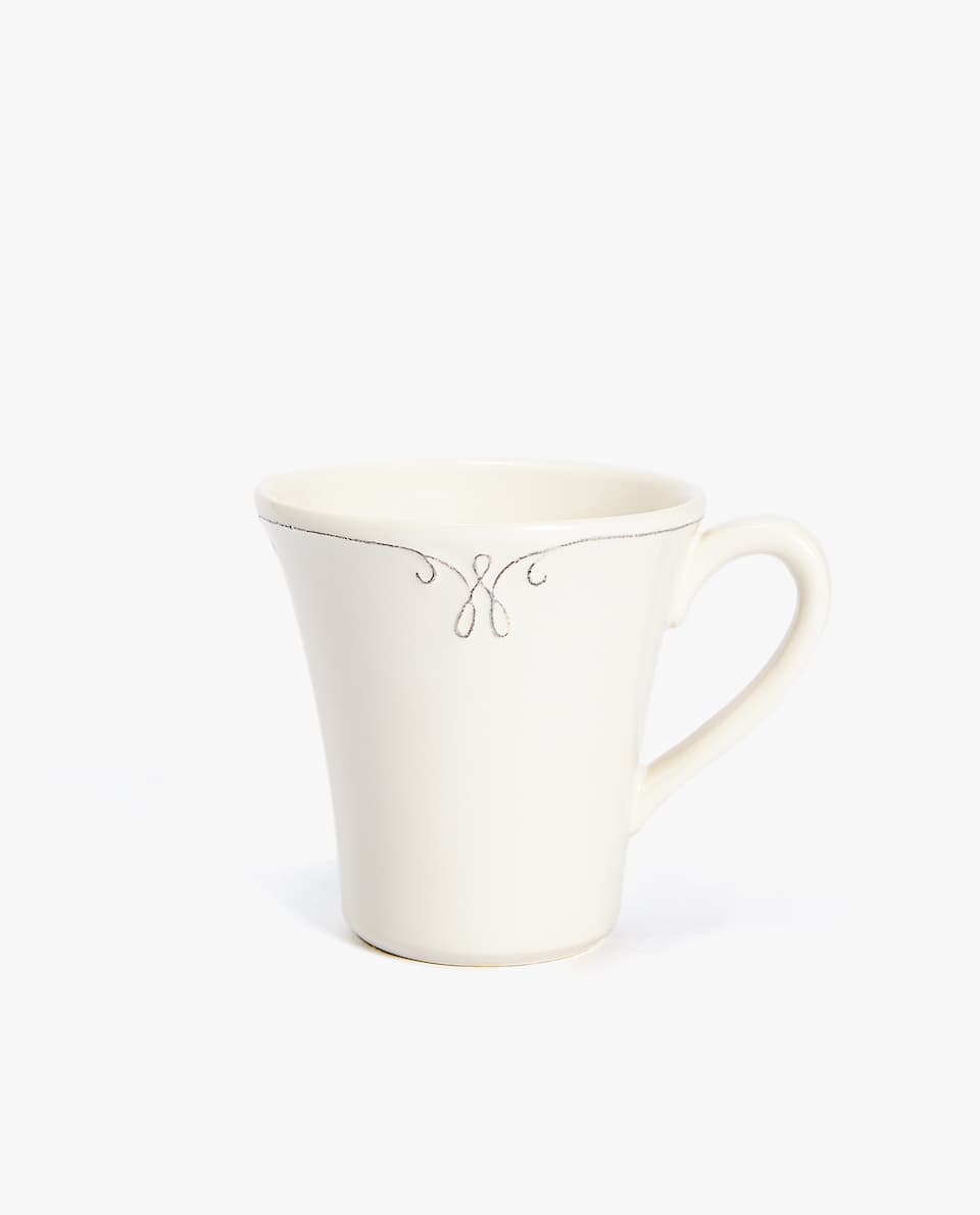 EARTHENWARE MUG WITH RAISED DESIGN RIM