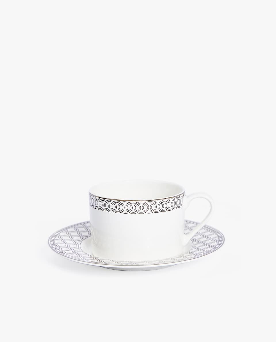 PORCELAIN TEACUP AND SAUCER WITH SILVER RIM