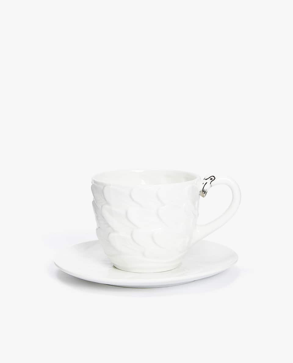 PORCELAIN TEA MUG AND SAUCER WITH SILVER DETAIL