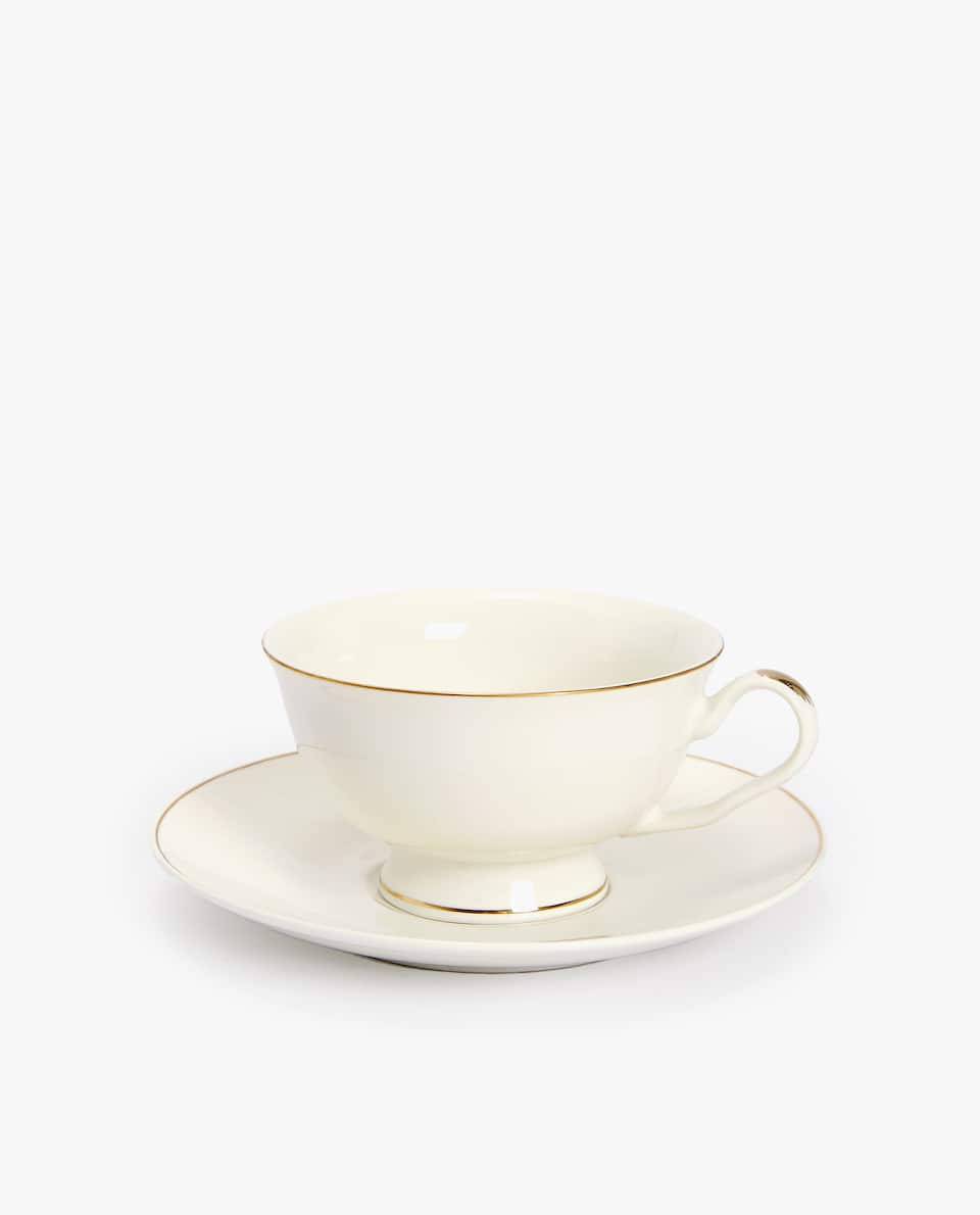PORCELAIN TEACUP AND SAUCER WITH GOLD RIM