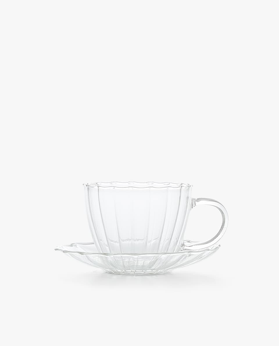 SCALLOPED GLASS TEACUP AND SAUCER