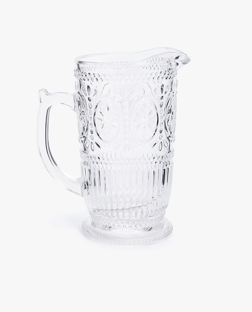 RAISED FLORAL DESIGN GLASS JUG