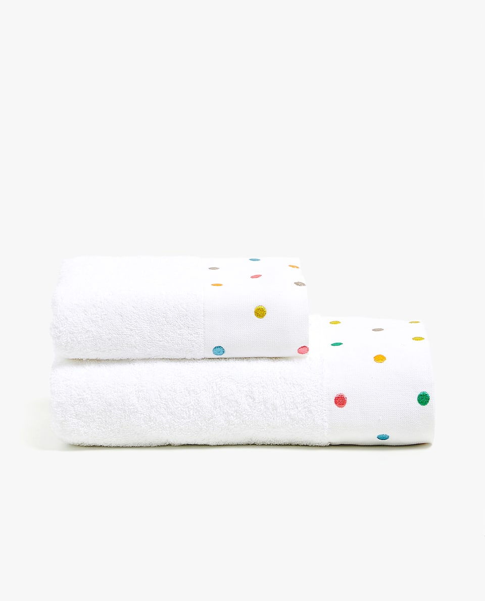 TOWEL WITH EMBROIDERED POLKA DOTS