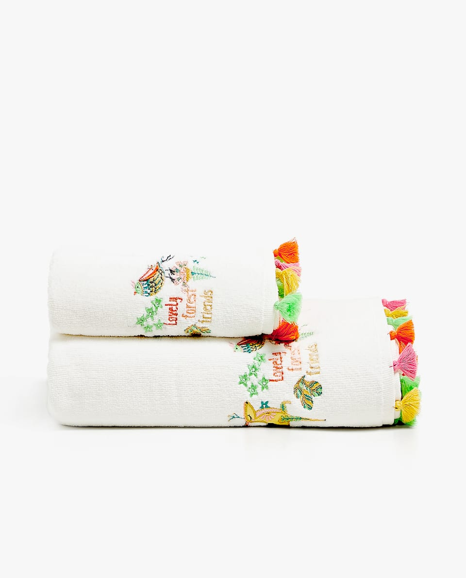 EMBROIDERED TOWEL WITH POMPOMS