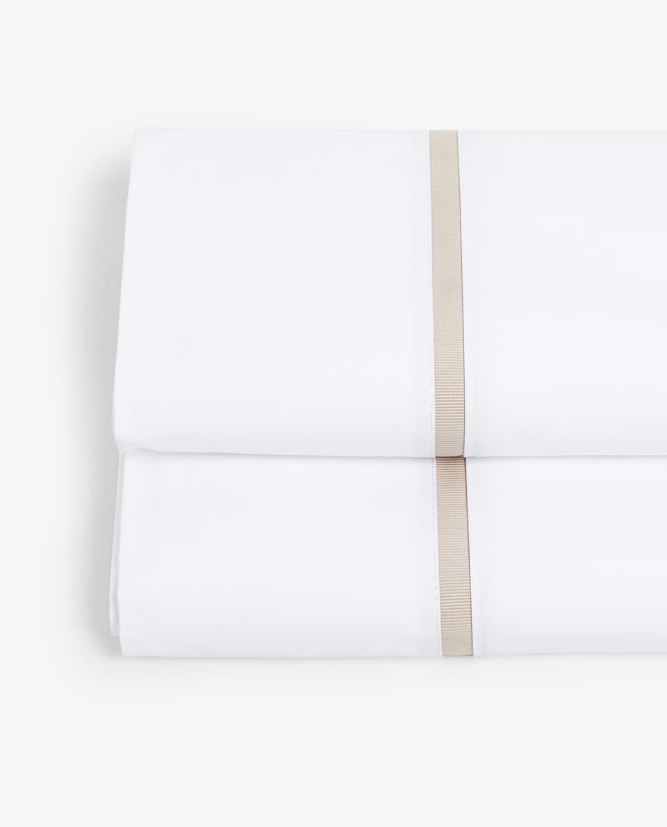 FLAT SHEET WITH CONTRASTING BEIGE RIBBON