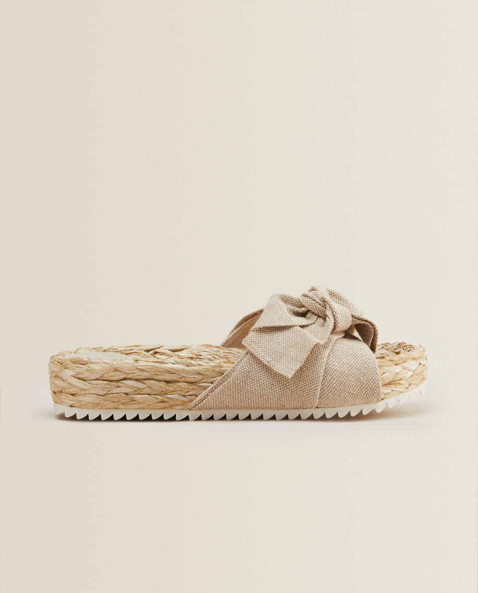 RAFFIA SANDALS WITH BOW DETAIL