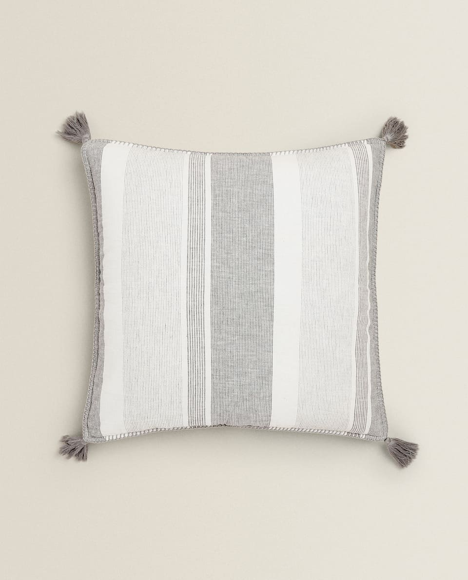 WASHED EFFECT CUSHION COVER WITH TASSELS