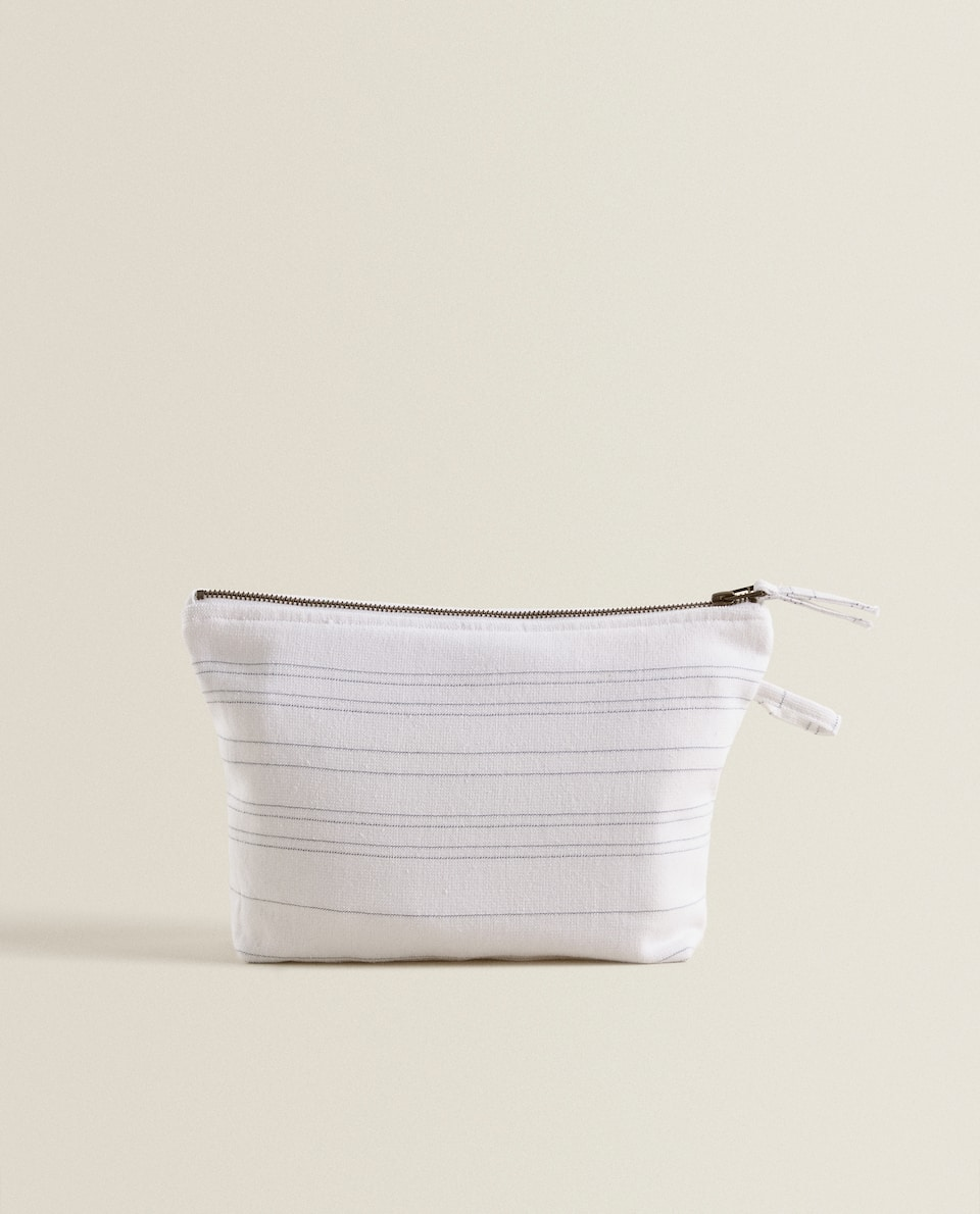 COTTON LINES TOILETRY BAG.